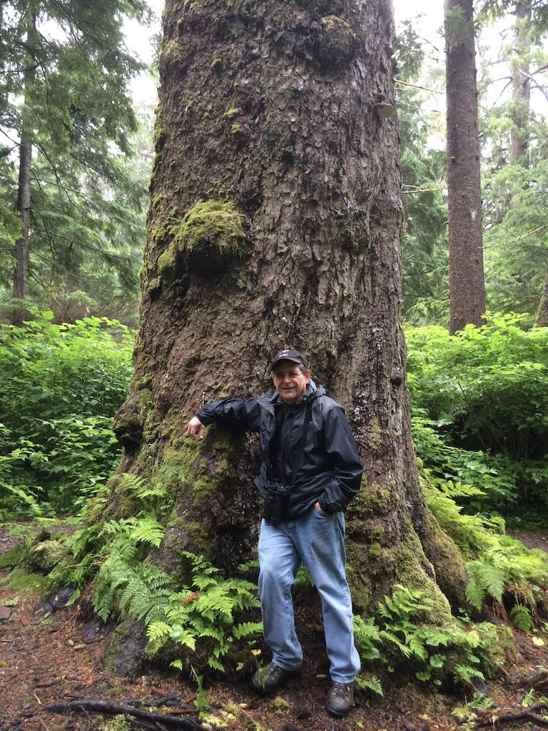Alan with tree in Alaska